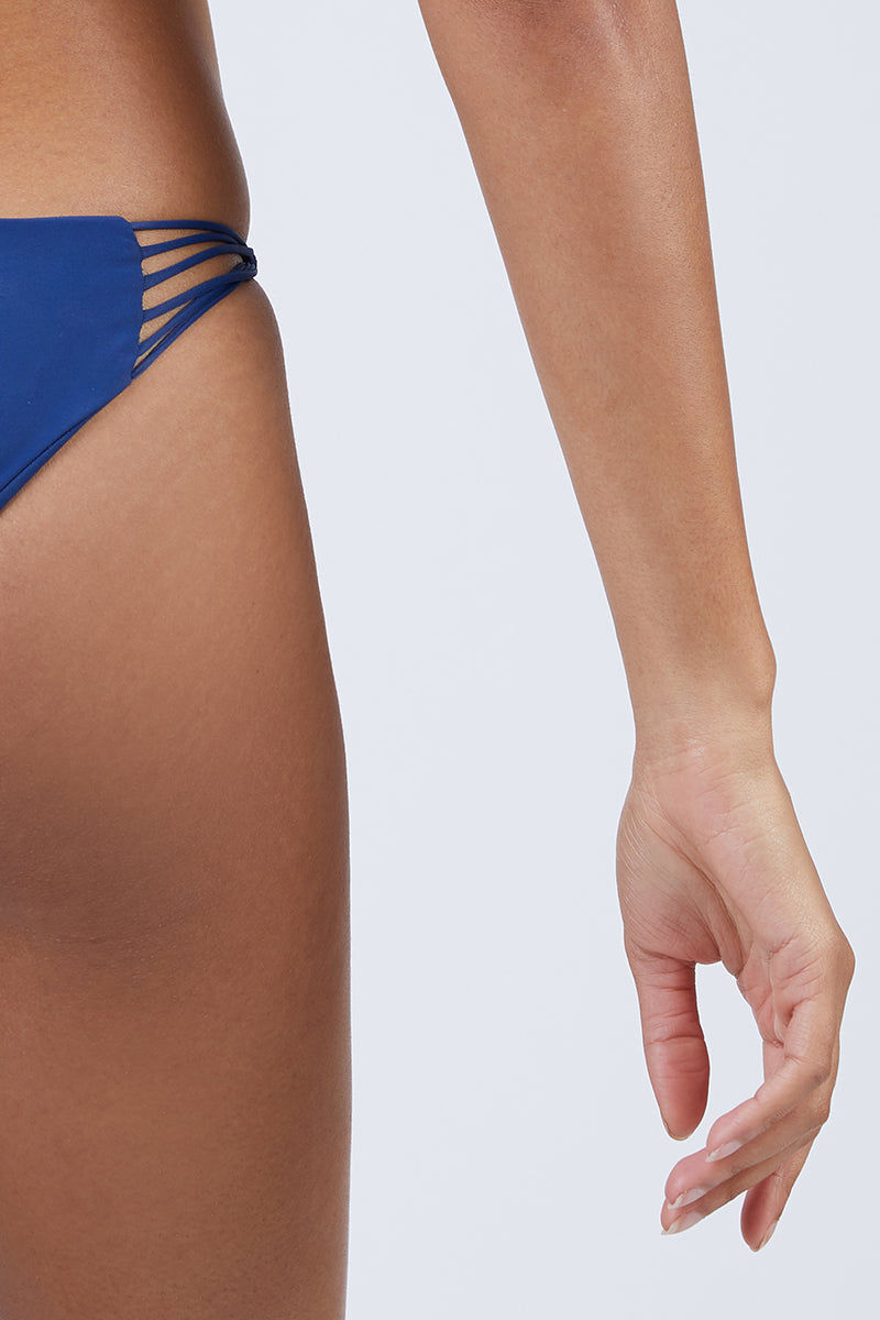 MIKOH Lanai Strappy Cheeky Bikini Bottom - Coastal Blue Bikini Bottom | Coastal Blue| Mikoh Lanai Bikini Bottom Close View Low-Rise Bikini Bottom Multi-Sting side Straps Cheeky Rear Coverage Double Lined Seamless Hardware-Free