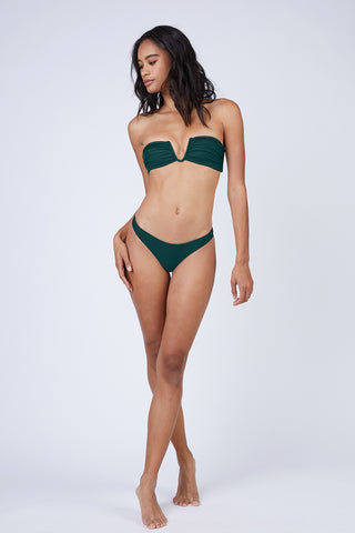 MIKOH Lahaina Low Rise Bikini Bottom - Kelp Bikini Bottom | Kelp| Mikoh Lahaina Low Rise Bikini Bottom - Kelp. Features: Low-rise brazilian cut bikini bottom in luxe solid blue-green fabric. Low rise cut and minimal coverage minimize tan lines and hug your curves without digging into your skin. View: On model, full front view.