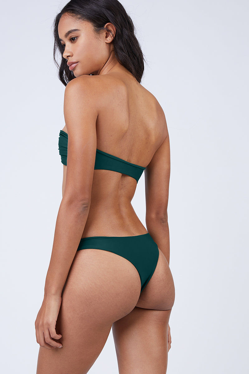 MIKOH Lahaina Low Rise Bikini Bottom - Kelp Green Bikini Bottom | Kelp Green| Mikoh Lahaina Low Rise Bikini Bottom - Kelp Green. Features: Low-rise brazilian cut bikini bottom in luxe solid blue-green fabric. Low rise cut and minimal coverage minimize tan lines and hug your curves without digging into your skin. Back View