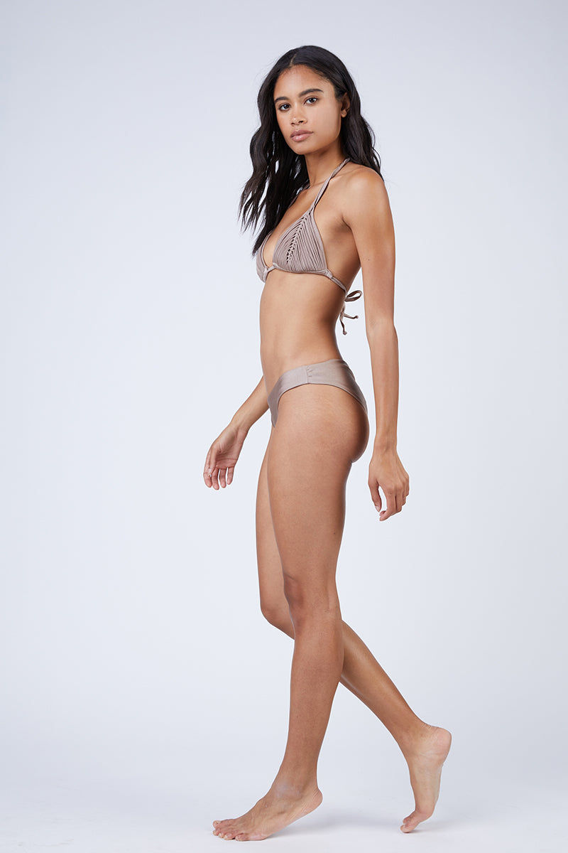 PILYQ Basic Ruched Teeny Bikini Bottom - Sandstone Nude Bikini Bottom | Sandstone Nude| Pilyq Basic Ruched Teeny Bikini Bottom - Sandstone Nude Low-rise hipster style scrunch butt cheeky bikini bottom in nude brown. Easy pull-on style with wide side straps and hipster-style cut Side View