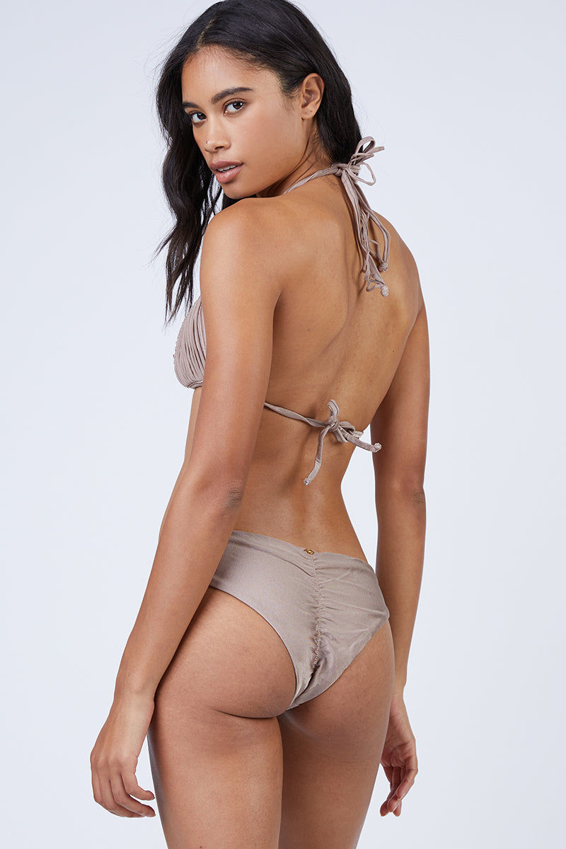 PILYQ Basic Ruched Teeny Bikini Bottom - Sandstone Nude Bikini Bottom | Sandstone Nude| Pilyq Basic Ruched Teeny Bikini Bottom - Sandstone Nude Low-rise hipster style scrunch butt cheeky bikini bottom in nude brown. Easy pull-on style with wide side straps and hipster-style cut Back View