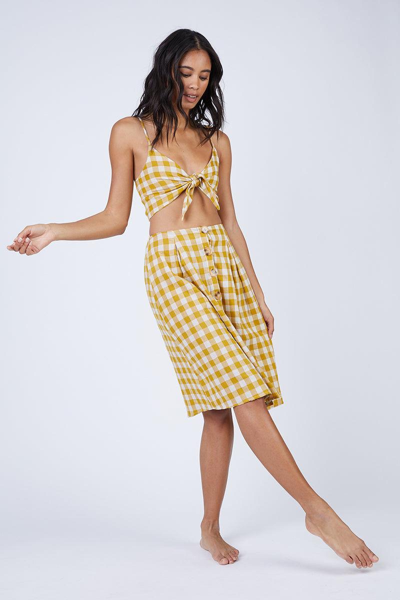 REVERSE Ryna Skirt - Mustard Gingham Print Skirt | Mustard Gingham Print| REVERSE Ryna Skirt - Mustard Gingham Print Feminine high-waisted button front midi skirt in a mustard yellow gingham print. Front View