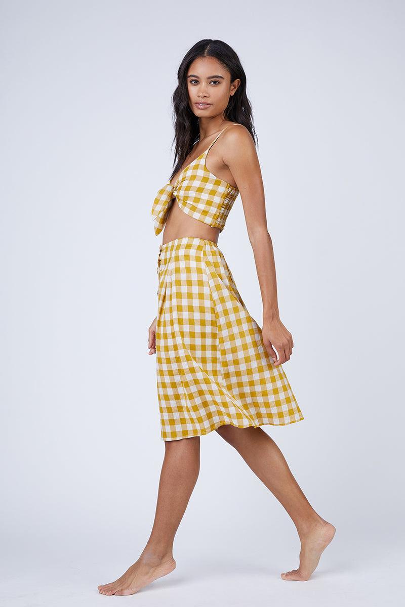 REVERSE Ryna Skirt - Mustard Gingham Print Skirt | Mustard Gingham Print| REVERSE Ryna Skirt - Mustard Gingham Print Feminine high-waisted button front midi skirt in a mustard yellow gingham print. Side View