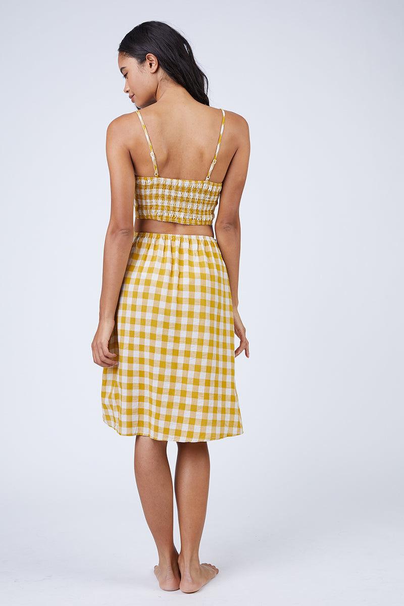 REVERSE Ryna Skirt - Mustard Gingham Print Skirt | Mustard Gingham Print| REVERSE Ryna Skirt - Mustard Gingham Print Feminine high-waisted button front midi skirt in a mustard yellow gingham print. Back View