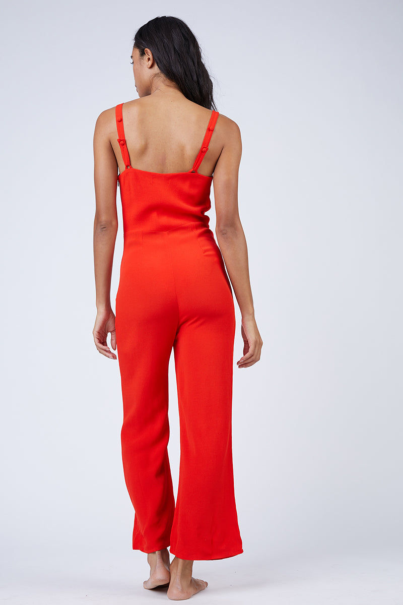FLYNN SKYE Joelle Front Tie Jumpsuit - Red Hot Jumpsuit | Red Hot| Flynn Skye Joelle Front Tie Jumpsuit - Red Hot Sweetheart Neckline Shoulder Straps  Front Bow Tie Detail  Ankle Grazing Hem  Unlined  Dry Clean Only  100% Rayon  Back View