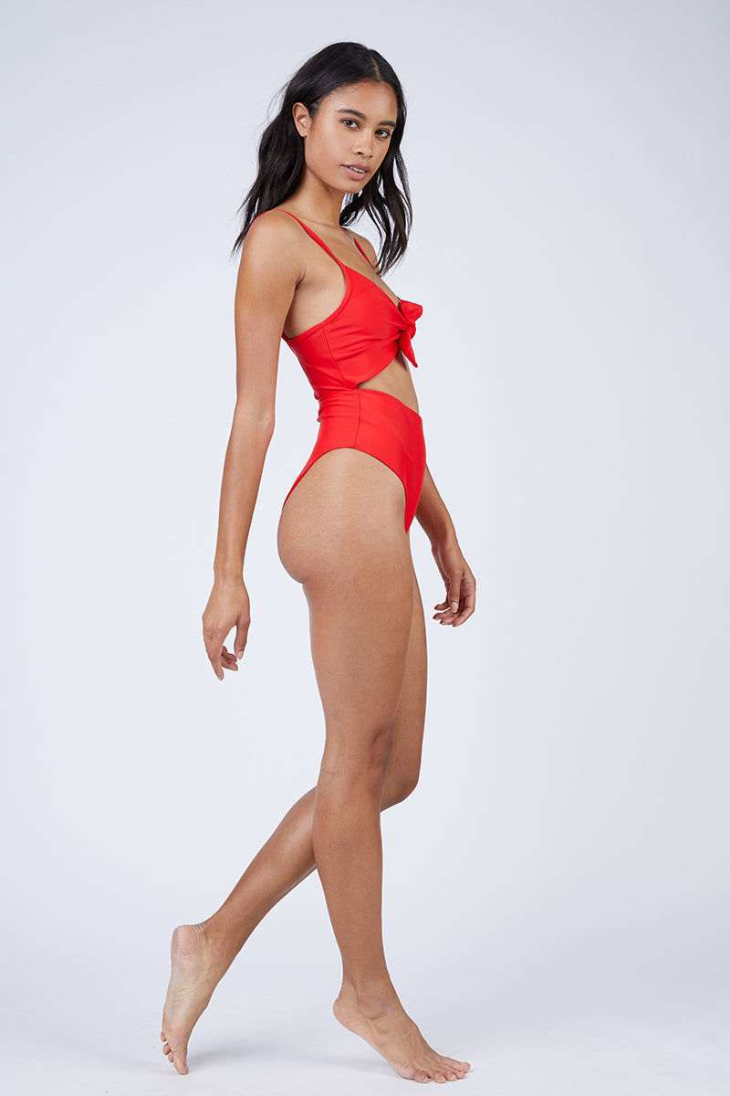 REVERSE Elora Front Cut Out One Piece Swimsuit - Red One Piece | Red| REVERSE Elora Front Cut Out One Piece Swimsuit - Red V neckline  Front tie detail  Front cut out  Adjustable shoulder straps  High cut leg  Cheeky coverage Front View
