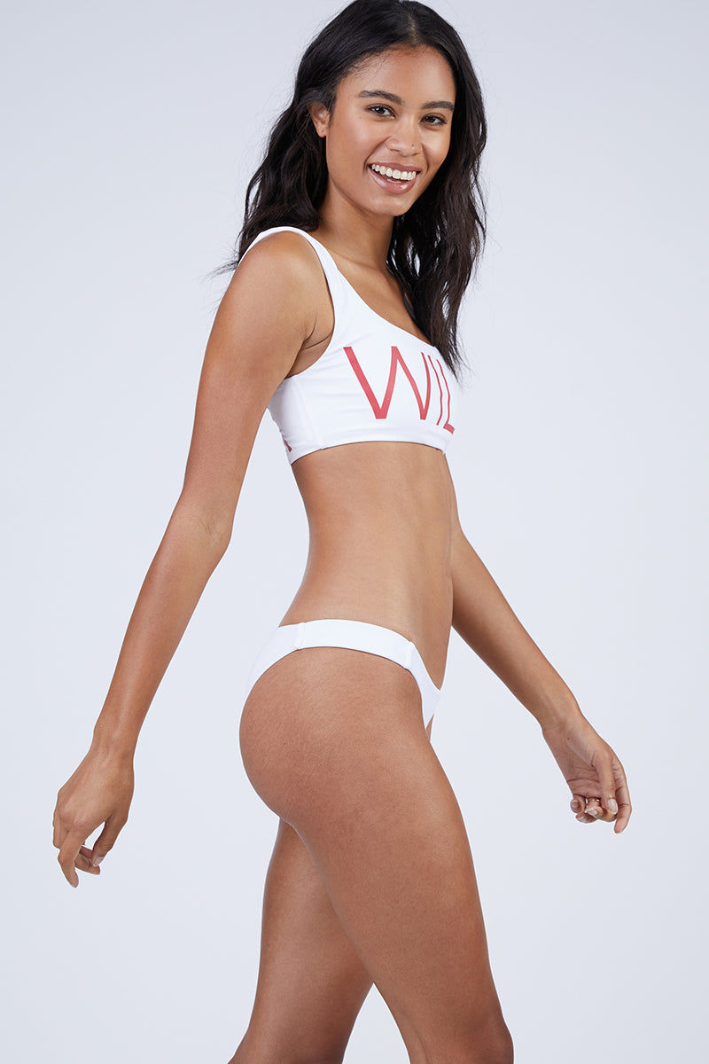 "WILDFOX Wildfox Crop Tank - White Bikini Top | White| Wildfox Wildfox Crop Tank - White Sporty Classic White Tank Style Bikini Top Red ""WILD"" Print on Front ""FOX"" Print on Back Wide Shoulder Straps Scoop Neckline Reversible"