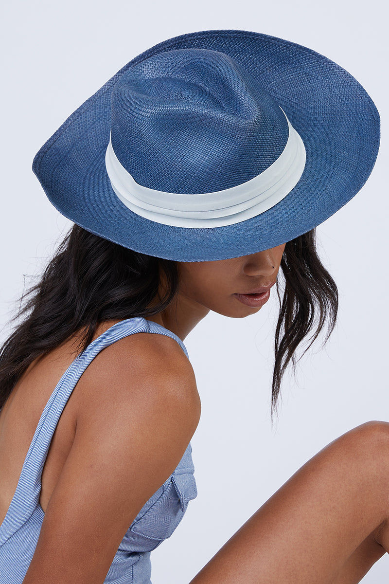 KAYU Coiba Straw Panama Hat - Blue Hat | Blue| Kayu Coiba Hat - Blue This classic Panama hat Made of Toquilla straw and features a grosgrain band Handcrafted by skilled artisans in Ecuador Size Guide:   56-57 cm with adjustable band One size fits most  Side View