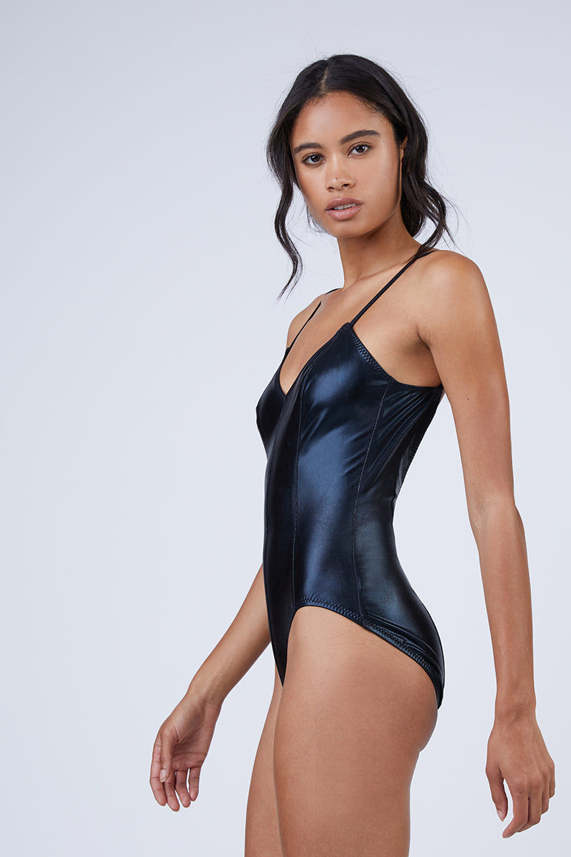 NORMA KAMALI Wonderwoman Mio V Neck One Piece Swimsuit - Black One Piece | Black| Norma Kamali Wonderwoman Mio V Neck One Piece Swimsuit - Black V neckline  Thin shoulder straps  High cut leg  Moderate coverage Side View