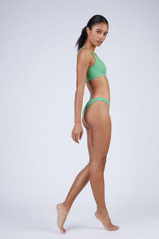 WILDASTER Blake Hipster Cheeky Bikini Bottom - Spearmint Green Bikini Bottom | Spearmint Green| Wildaster Blake Hipster Cheeky Bikini Bottom - Spearmint Green Low Rise Bottom  Cheeky-Moderate Coverage  Seamless Stitching Double Lined  80% Nylon / 20% Spandex Side View