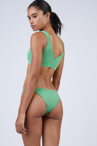 WILDASTER Blake Hipster Cheeky Bikini Bottom - Spearmint Green Bikini Bottom | Spearmint Green| Wildaster Blake Hipster Cheeky Bikini Bottom - Spearmint Green Low Rise Bottom  Cheeky-Moderate Coverage  Seamless Stitching Double Lined  80% Nylon / 20% Spandex Back View