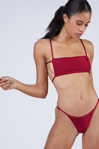 WILDASTER Maya Thin Strap Thong Bikini Bottom - Shanghai Red Bikini Bottom | Shanghai Red| Wildaster Maya Thin Strap Thong Bikini Bottom - Shanghai Red Single Side Straps Skimpy Coverage  Seamless Stitching Double Lined  80% Nylon / 20% Spandex Front View