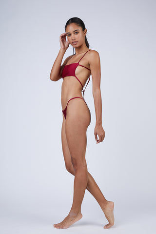 WILDASTER Maya Thin Strap Thong Bikini Bottom - Shanghai Red Bikini Bottom | Shanghai Red| Wildaster Maya Thin Strap Thong Bikini Bottom - Shanghai Red Single Side Straps Skimpy Coverage  Seamless Stitching Double Lined  80% Nylon / 20% Spandex Side View