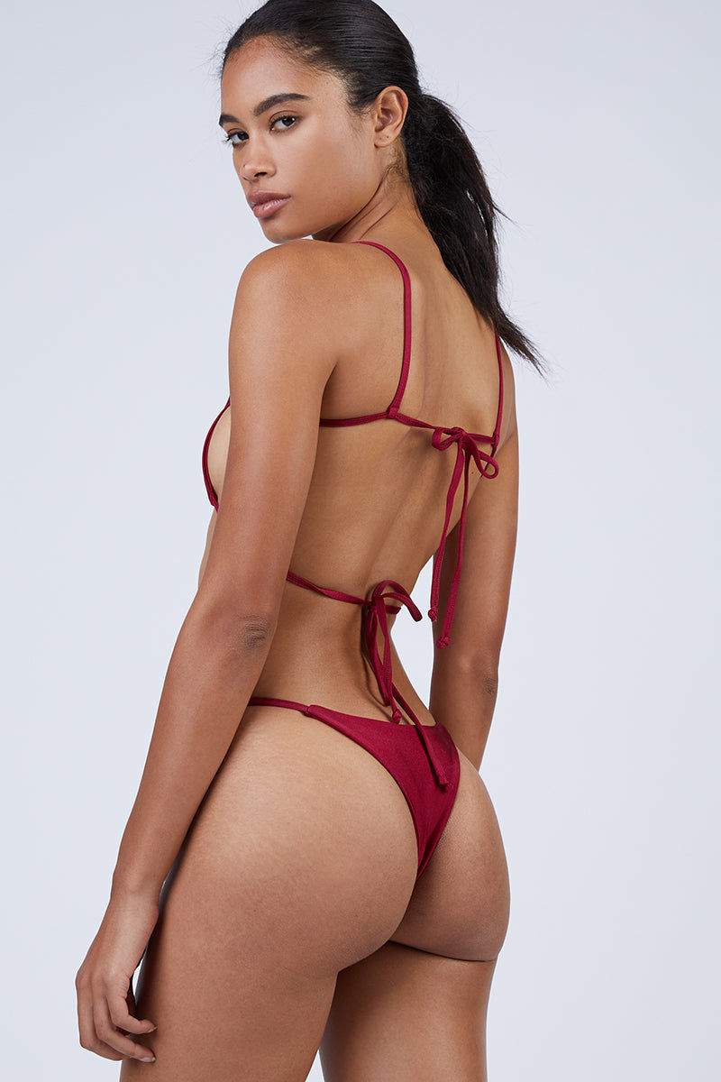 WILDASTER Maya Thin Strap Thong Bikini Bottom - Shanghai Red Bikini Bottom | Shanghai Red| Wildaster Maya Thin Strap Thong Bikini Bottom - Shanghai Red Single Side Straps Skimpy Coverage  Seamless Stitching Double Lined  80% Nylon / 20% Spandex Back View