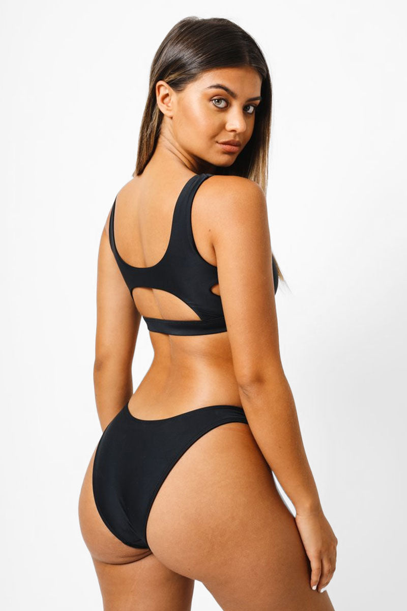 KAOHS Abby Cut Out Bikini Top - Black Bikini Top   Black  Kaohs Abby Cut Outs Bikini Top - Black Scoop neckline  Front knot detail  Front, side, and back cut out detail Thick bra band   Back View