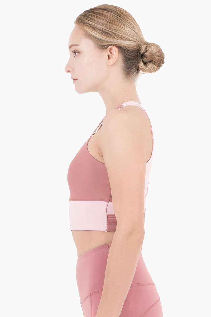 NYLORA Aria Cropped Color Block Sports Bra - Dusty Pink/Peony Top | Dusty Pink & Peony Combo| Nylora Aria Cropped Tank - Dusty Pink & Peony Combo. Features:   High scoop neckline  Cropped style tank  Racerback detail  Colorblock detail  Side View