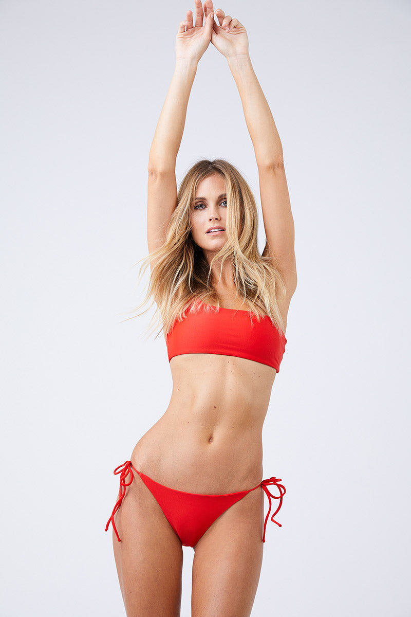 JADE SWIM Links Tie Sides Bikini Bottom - Lava Bikini Bottom   Lava  Jade Swim Links Tie Sides Bikini Bottom - Lava Tie Side Bottom  Moderate Coverage  Made in Los Angeles 82% Nylon, 18% Lycra Spandex Care  Hand wash, lay flat to dry Chlorine, oil and cream resistant Front View