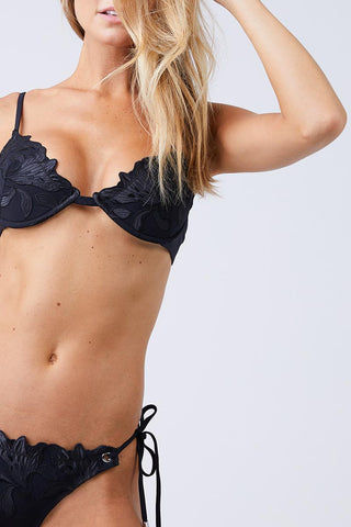 FLEUR DU MAL Lily Underwire Bikini Top - Black Bikini Top | Black| Fleur Du Mal Lily Underwire Bikini Top Lingerie-inspired padded black bikini top with delicate embroidered floral detail. Foam-lined bra-style underwire cups lift and accentuate the bust. Adjustable shoulder straps give extra lift and the perfect fit. Wide band secures at back with classic hook closure. Front View