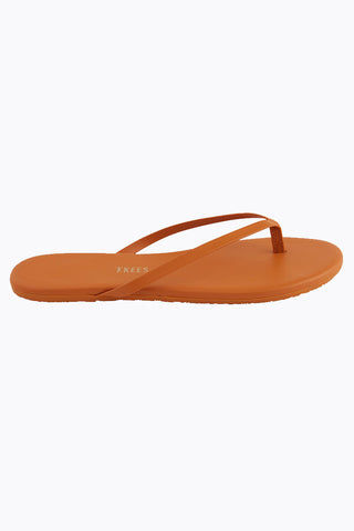 TKEES Solids Sandals - No. 35 Orange Sandals | No. 35 Orange| Tkees Solids Sandals - No. 35 Orange Classic Flip Flops in Burnt Orange Color Made in Brazil    Material:  Leather Upper Leather Insole Rubber Outsole Side View