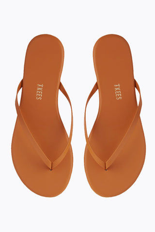 TKEES Solids Sandals - No. 35 Orange Sandals | No. 35 Orange| Tkees Solids Sandals - No. 35 Orange Classic Flip Flops in Burnt Orange Color Made in Brazil    Material:  Leather Upper Leather Insole Rubber Outsole Front View