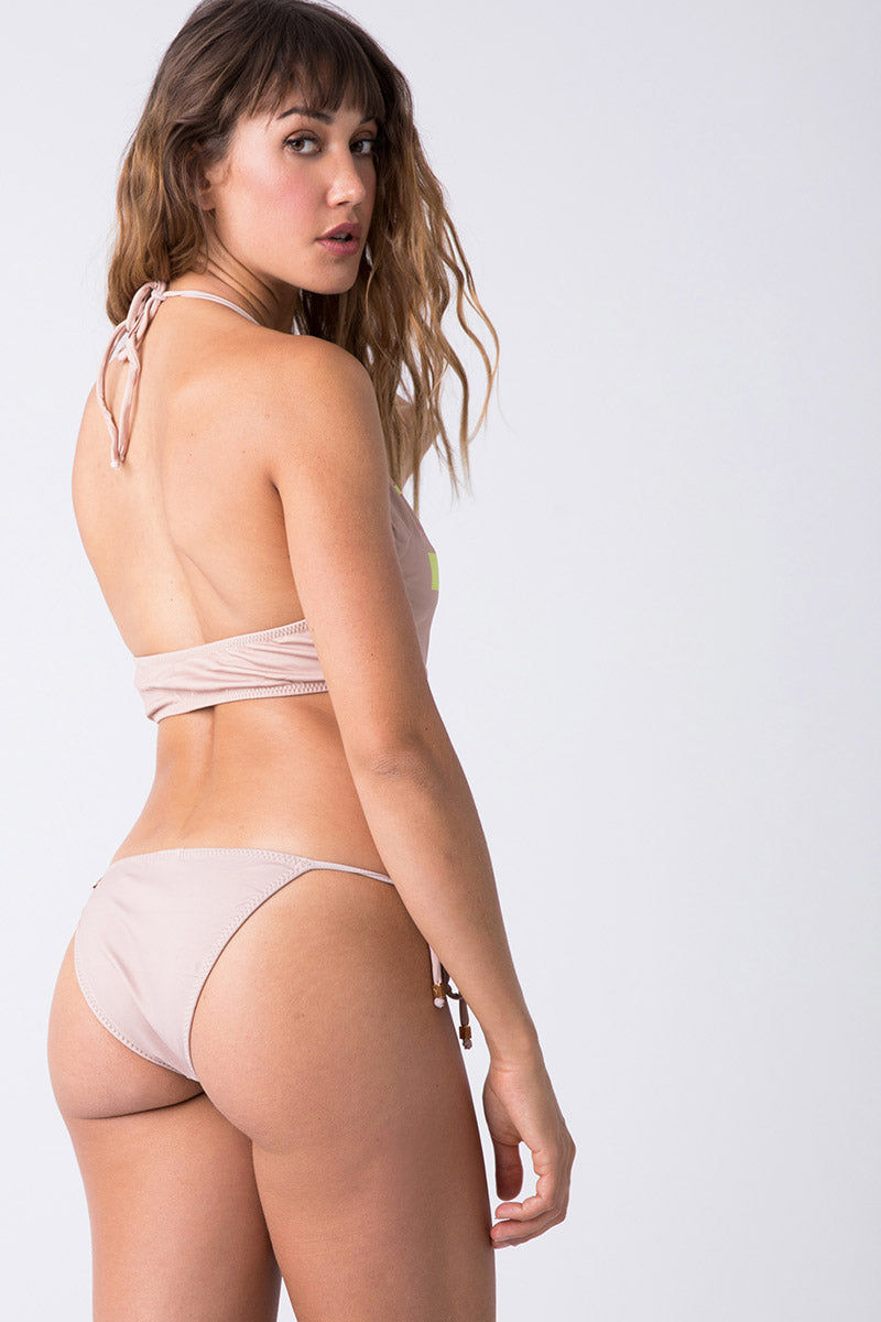 TRIYA Tie Side Metal Bikini Bottom - Tropical Bikini Bottom | Tropical| Triya Tie Side Metal Bottom - Tropical Back View Tie Side Bikini Bottom  Low Rise  Moderate Coverage  Metal Detail at the ends of the Strings 90% Polyamide, 10% Elastane Produced in Brazil Hand wash, cold and dry
