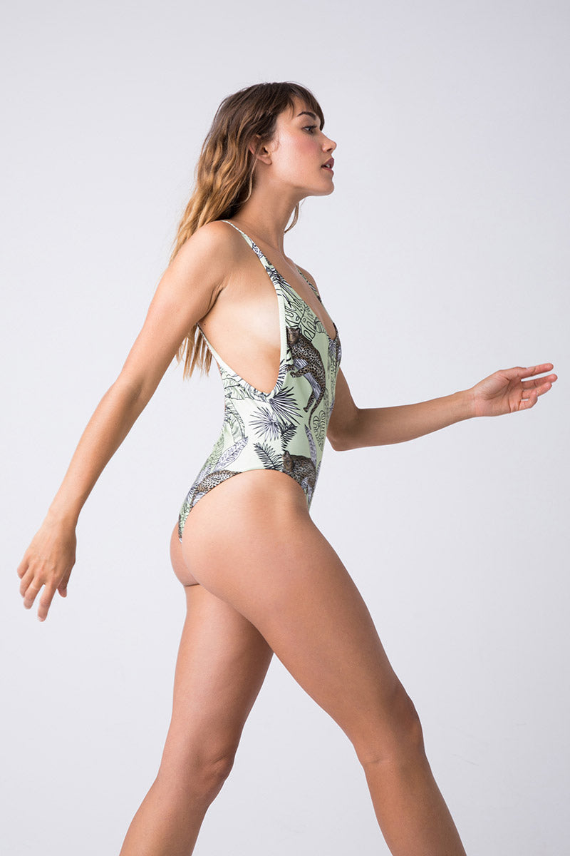 TRIYA Mermaid One Piece - Jungle Draw One Piece   Jungle Draw  Triya Mermaid One Piece - Jungle Draw Side View Melon green one piece with jungle print  Scoop Neckline  Side Boob Exposure  Spaghetti Straps  Low Scoop Back  Cheeky Coverage  High Cut Leg  84% Polyamide, 16% Elastane , 07% metallic fiber  Produced in Brazil  Hand wash, cold and dry ***print may vary according to the cut of the fabric
