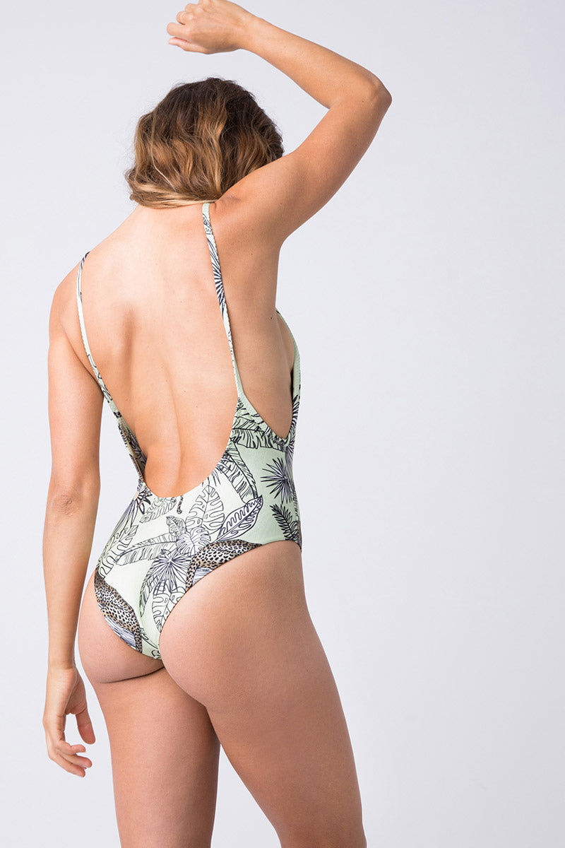 TRIYA Mermaid One Piece - Jungle Draw One Piece   Jungle Draw  Triya Mermaid One Piece - Jungle Draw Back View  Melon green one piece with jungle print  Scoop Neckline  Side Boob Exposure  Spaghetti Straps  Low Scoop Back  Cheeky Coverage  High Cut Leg  84% Polyamide, 16% Elastane , 07% metallic fiber  Produced in Brazil  Hand wash, cold and dry ***print may vary according to the cut of the fabric