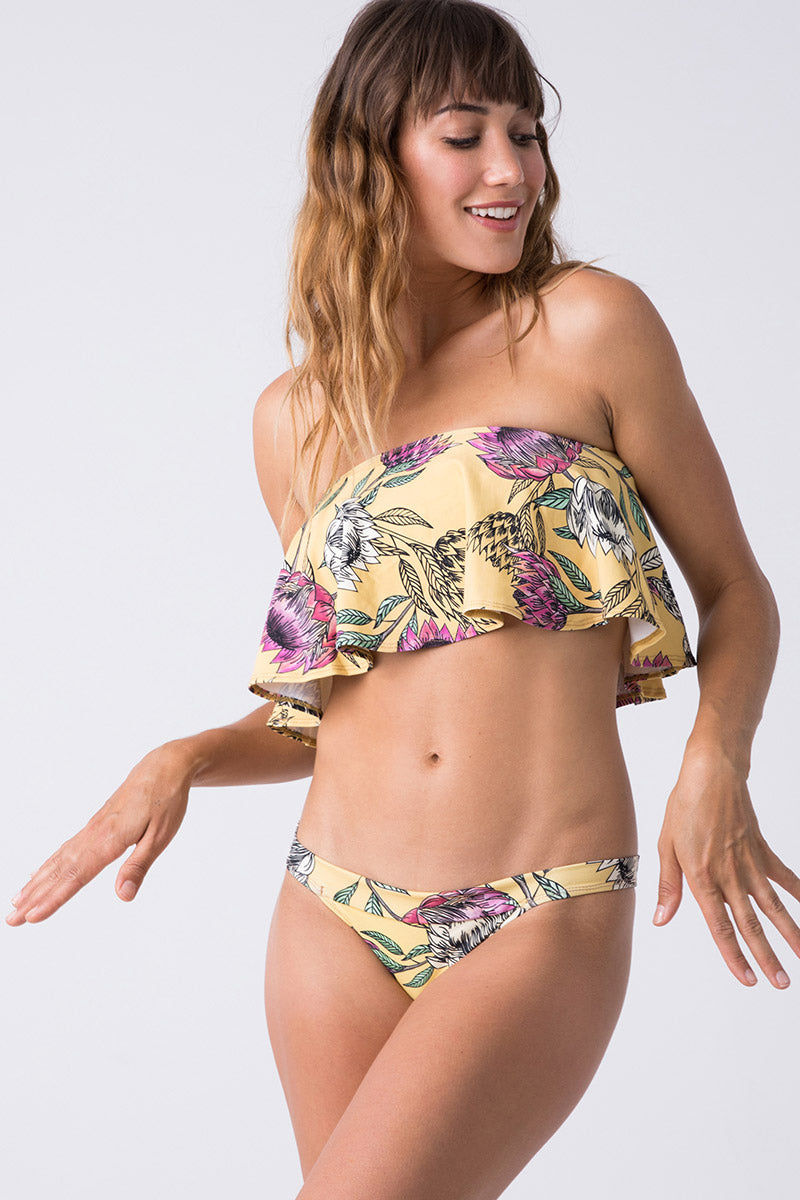 TRIYA Mira Bottom - Floral Tropical Bikini Bottom | Floral Tropical| Triya Mira Bottom - Floral Tropical Front View Thick Band  Cheeky Bottom  Moderate Coverage 90% Polyamide  10% Elastane  Produced in Brazil  Hand wash, cold and dry