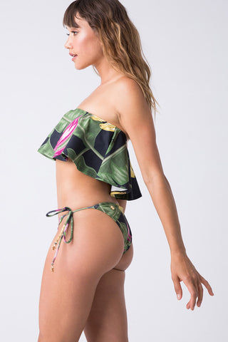 TRIYA Stela Off The Shoulder Flounce Bikini Top - Bananeira Bikini Top | Bananeira| Triya Stela Top - Bananeira Side View Black with Tropical Print Bandeau Top Ruffle Overlay  Off Shoulder Fabric: 90% Polyamide,10% Elastane  Produced in Brazil;  Hand wash, cold and dry