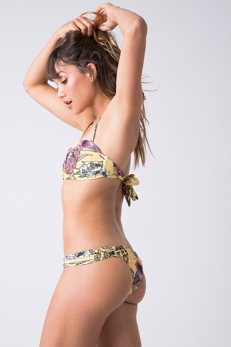 TRIYA Looped Metal Bandeau Bikini Top - Floral Tropical Bikini Top | Floral Tropical| Triya Looped Metal Bandeau Top - Floral Tropical Side View Bandeau Top  Sweetheart Neckline  Vertical Metal Detail  Back Tie Closure Produced in Brazil Hand wash, cold and dry
