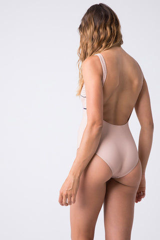 "TRIYA U Neckline One Piece - Topless One Piece | Topless| Triya U Neckline One Piece - Topless Back View U Neckline  Beige One Piece  ""TOPLESS"" in Pink Font  Female Outline on the Front  Low Scoop Back  High Cut Leg Full Coverage  90% Polyamide, 10% Elastane Produced in Brazil Hand wash, cold and dry"