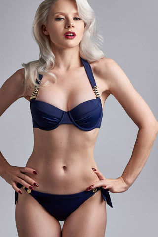 MARLIES DEKKERS Padded Plunge Balcony Bikini Top - Royal Navy Bikini Top | Royal Navy| Marlies Dekkers Padded Plunge Balcony Bikini Top - Royal Navy. Features:  The gold colored & maritime inspired ornaments radiate luxury The padded cups give you extra support and the pleats accentuate your curves Handle this beautiful bikini top with care and wash it by hand Materials: 82% nylon 18% spandex | nickel free Front View