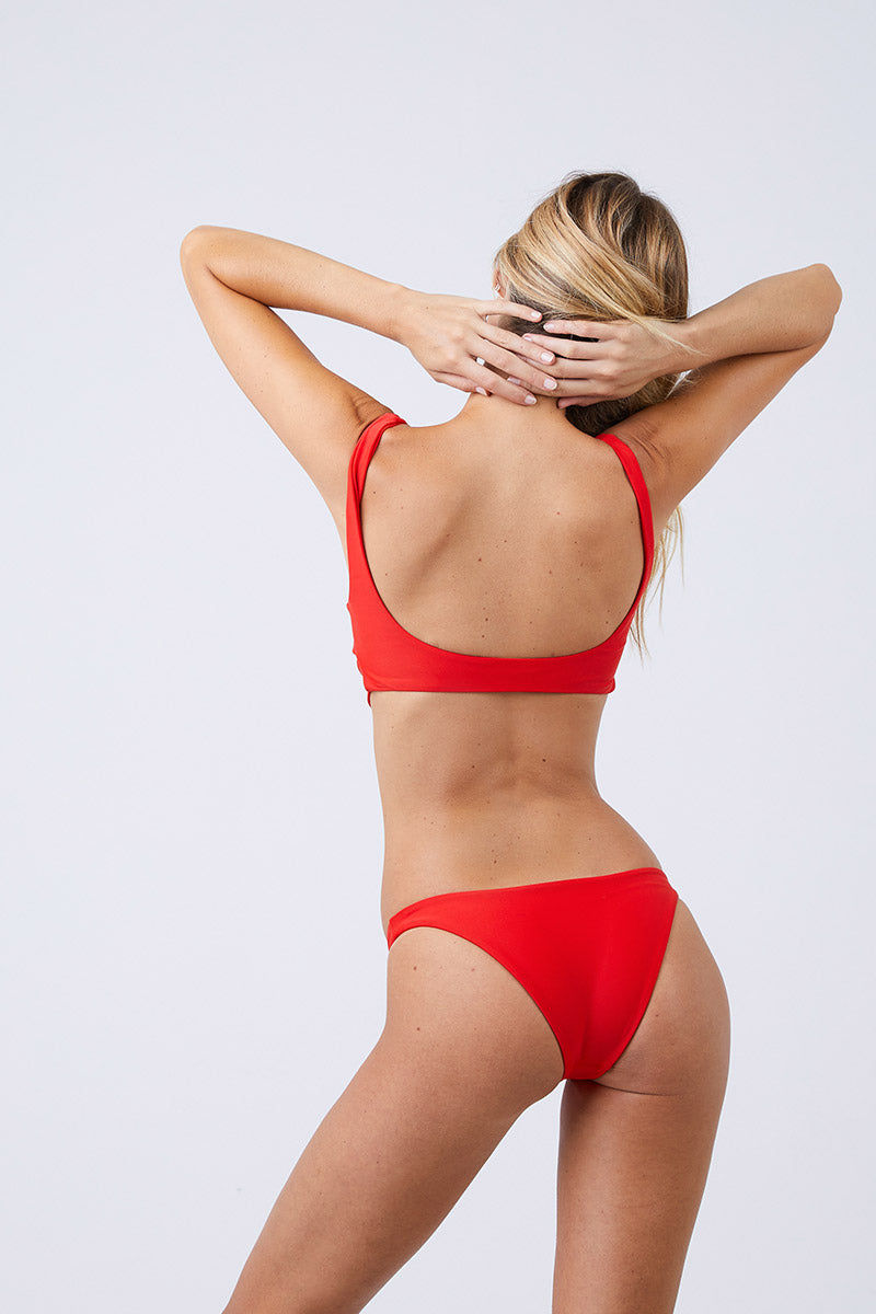 JADE SWIM Bond Wrap Bikini Top - Lava Bikini Top | Lava| Jade Swim Bond Wrap Bikini Top - Lava Scoop Neck Wrap Top  Thick Straps  Thin Back Band  82% Nylon, 18% Spandex Made in Los Angeles Care  Hand wash, lay flat to dry Chlorine, oil and cream resistant Back View