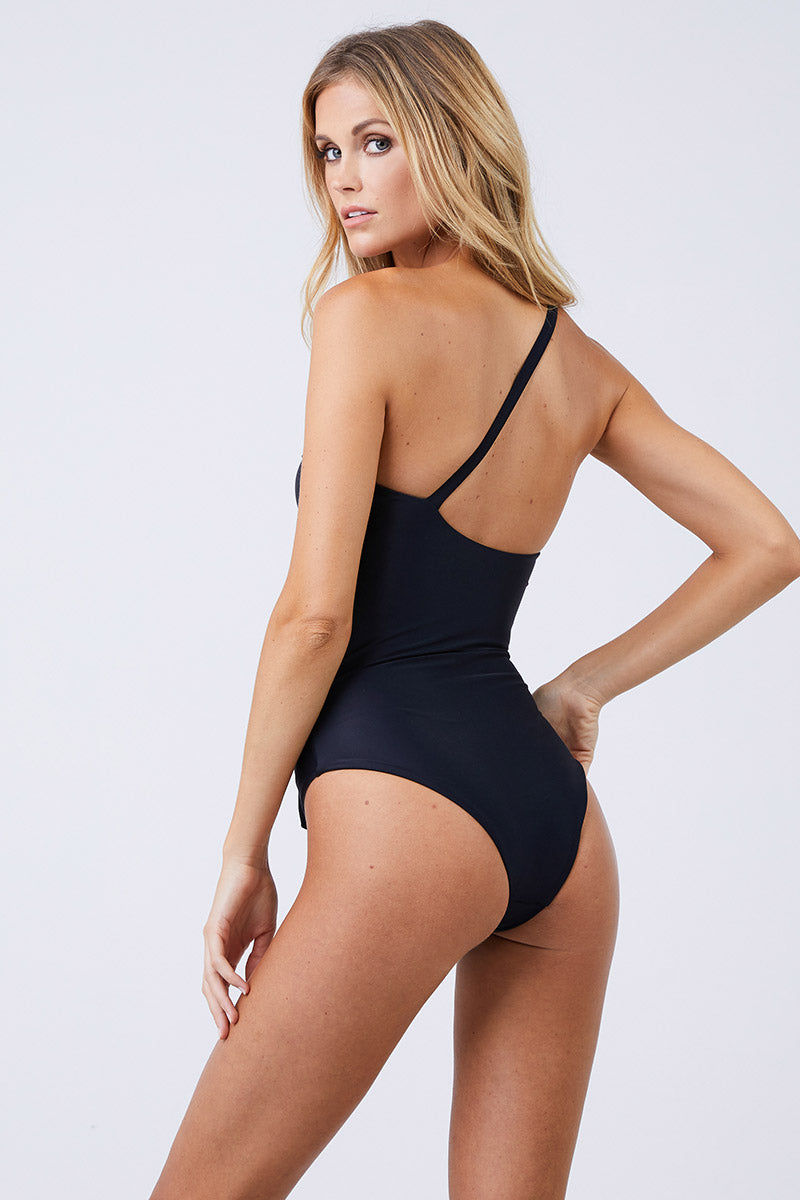 JADE SWIM Collision Cut Out One Piece Swimsuit - Black One Piece | Black| Jade Swim Collision Cut Out One Piece Swimsuit - Black Back View All Black Asymmetrical One Shoulder One Piece Off Center Front Cut Outs Knot Tie Detail Single Thin Back Strap Moderate Coverage UV Protective Oil/Cream/Chlorine Resistant Fabric