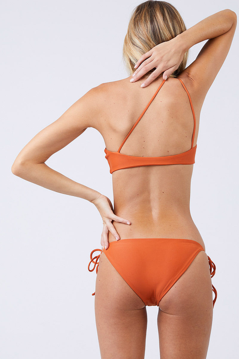 JADE SWIM Apex One Shoulder Bikini Top - Amber Bikini Top | Amber|Jade Swim Apex One Shoulder Bikini Top - Amber. - STYLE:  Asymmetrical one shoulder bikini top in a burnt orange shade Amber Modern one-shoulder wide strap cascades into thin double back straps to show off your shoulders. Wide shoulder strap provides support for your bust and offers the perfect amount of lift. Back View