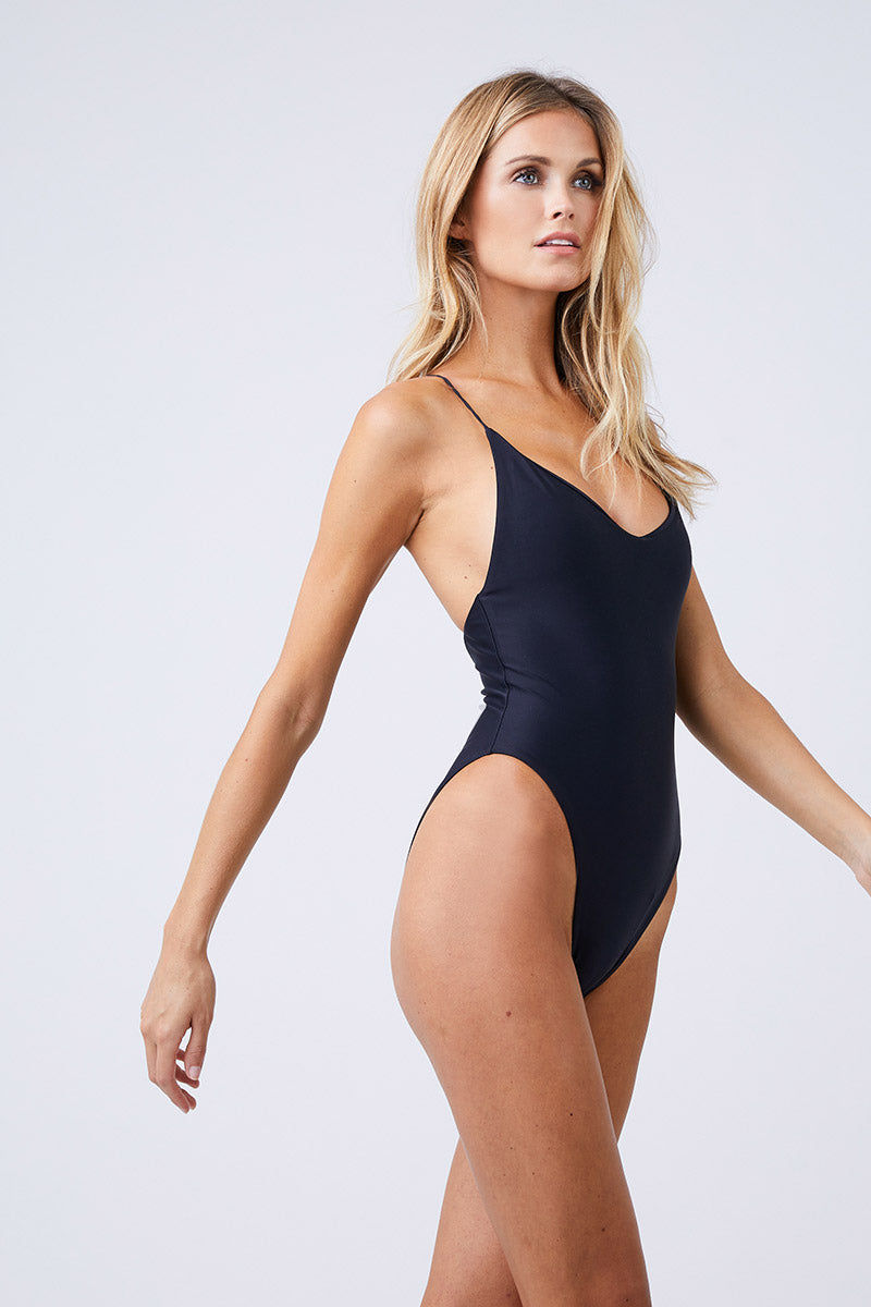 JADE SWIM Links Scoop Neckline One Piece Swimsuit - Black One Piece | Black| Jade Swim Links Scoop Neckline One Piece Swimsuit - Black Scoop Slight V  Neckline  Thin Spaghetti Straps  Interlocking Criss Cross Back Straps High Cut Leg  Cheeky Coverage  Made in Los Angeles 82% Nylon, 18% Lycra Spandex Care  Hand wash, lay flat to dry Chlorine, oil and cream resistant Side View
