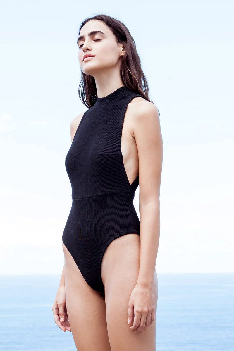 HAIGHT Kate Knit High Neck One Piece Swimsuit - Black One Piece | Black| Haight Kate Knit High Neck One Piece Swimsuit - Black High neckline  Side boob  High cut leg  Cheeky coverage  Side View