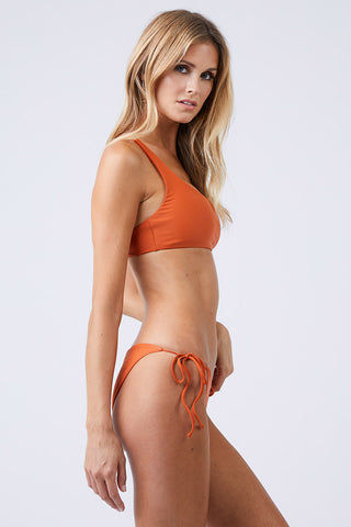 JADE SWIM Apex One Shoulder Bikini Top - Amber Bikini Top | Amber|Jade Swim Apex One Shoulder Bikini Top - Amber. - STYLE:  Asymmetrical one shoulder bikini top in a burnt orange shade Amber Modern one-shoulder wide strap cascades into thin double back straps to show off your shoulders. Wide shoulder strap provides support for your bust and offers the perfect amount of lift. Side View