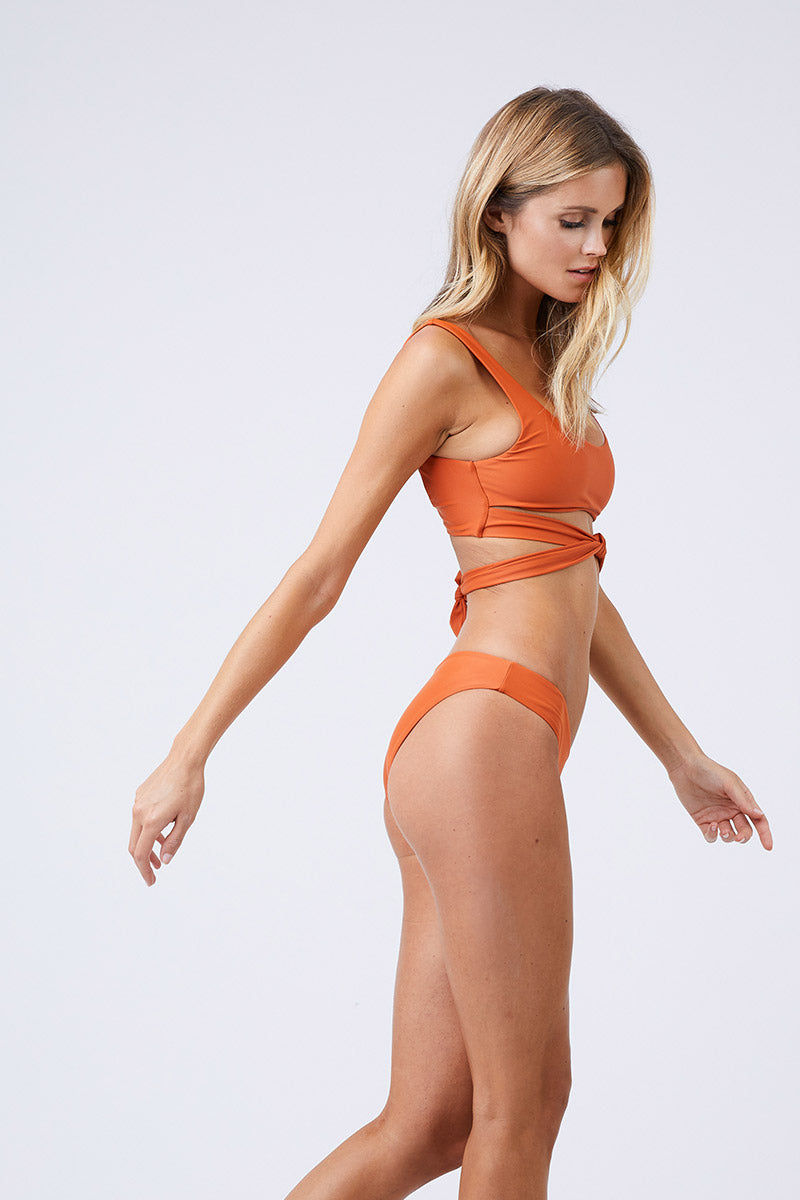 JADE SWIM Bond Wrap Bikini Top - Amber Bikini Top | Amber| Jade Swim Bond Wrap Bikini Top - Amber Scoop Neck Wrap Top  Thick Straps  Thin Back Band  82% Nylon, 18% Spandex Made in Los Angeles Care  Hand wash, lay flat to dry Chlorine, oil and cream resistant. Side View