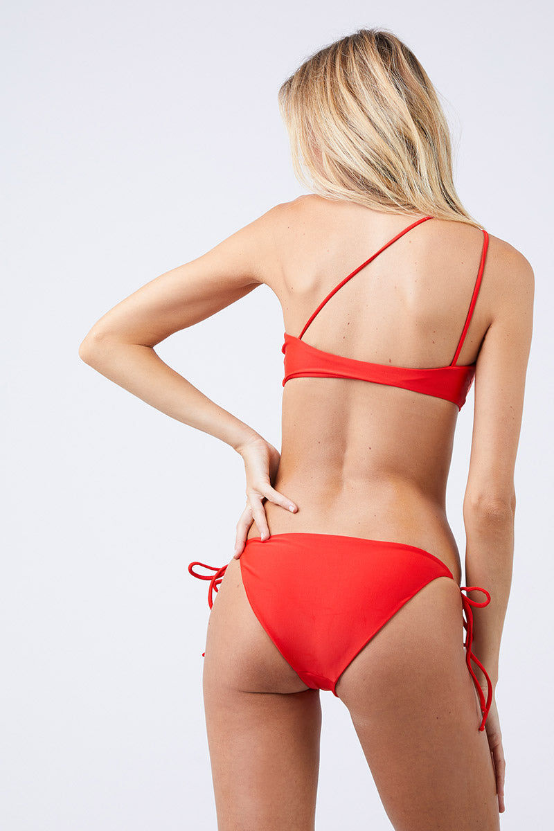 JADE SWIM Links Tie Sides Bikini Bottom - Lava Bikini Bottom   Lava  Jade Swim Links Tie Sides Bikini Bottom - Lava Tie Side Bottom  Moderate Coverage  Made in Los Angeles 82% Nylon, 18% Lycra Spandex Care  Hand wash, lay flat to dry Chlorine, oil and cream resistant Back View