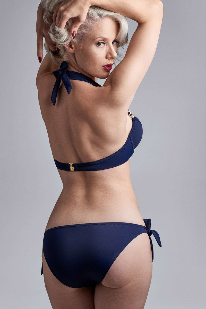 MARLIES DEKKERS Padded Plunge Balcony Bikini Top - Royal Navy Bikini Top | Royal Navy| Marlies Dekkers Padded Plunge Balcony Bikini Top - Royal Navy. Features:  The gold colored & maritime inspired ornaments radiate luxury The padded cups give you extra support and the pleats accentuate your curves Handle this beautiful bikini top with care and wash it by hand Materials: 82% nylon 18% spandex | nickel free Back View