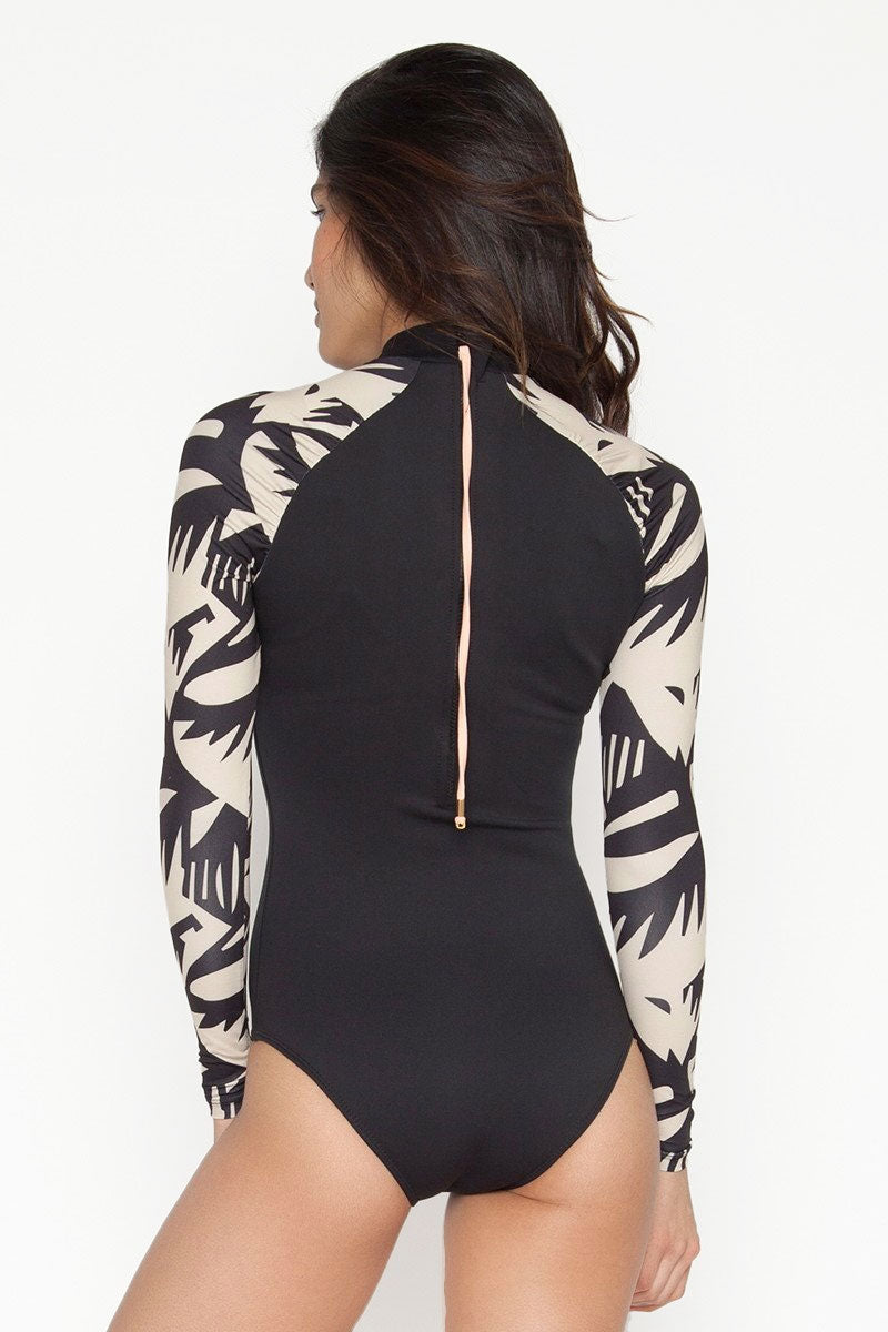 SEEA Gaviotos Color Block High Neck Zipper Rashguard Bodysuit - Buzios Abstract Print/Black One Piece | Buzios Abstract Print/Black | Seea Gaviotos Color Block High Neck Zipper Rashguard Bodysuit - Buzios Abstract Print/Black Features:  Recycled polyester/Spandex sleeves and polyester/spandex C-Skin fabric body. Fabric rated UPF 30+ - UPF 50+ Original Buzios print Unrestricting C-Skin petal collar Raglan cut with gathered ruching detail at the seam Back zipper closure Moderate coverage bottom Made in sunny California Back View