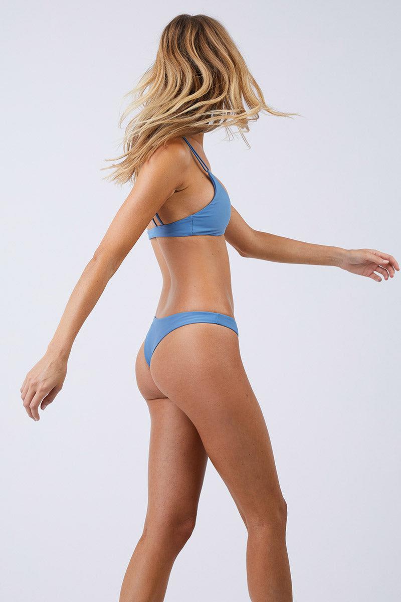 JADE SWIM Expose Low Rise Thong Bikini Bottom - Sky Bikini Bottom | Sky| Jade Swim Expose Low Rise Thong Bikini Bottom - Sky Side View Low-Rise Brazilian Cut Bikini Bottom Sky Blue Fabric Skimpy Front Coverage Cheeky Minimal Rear Coverage