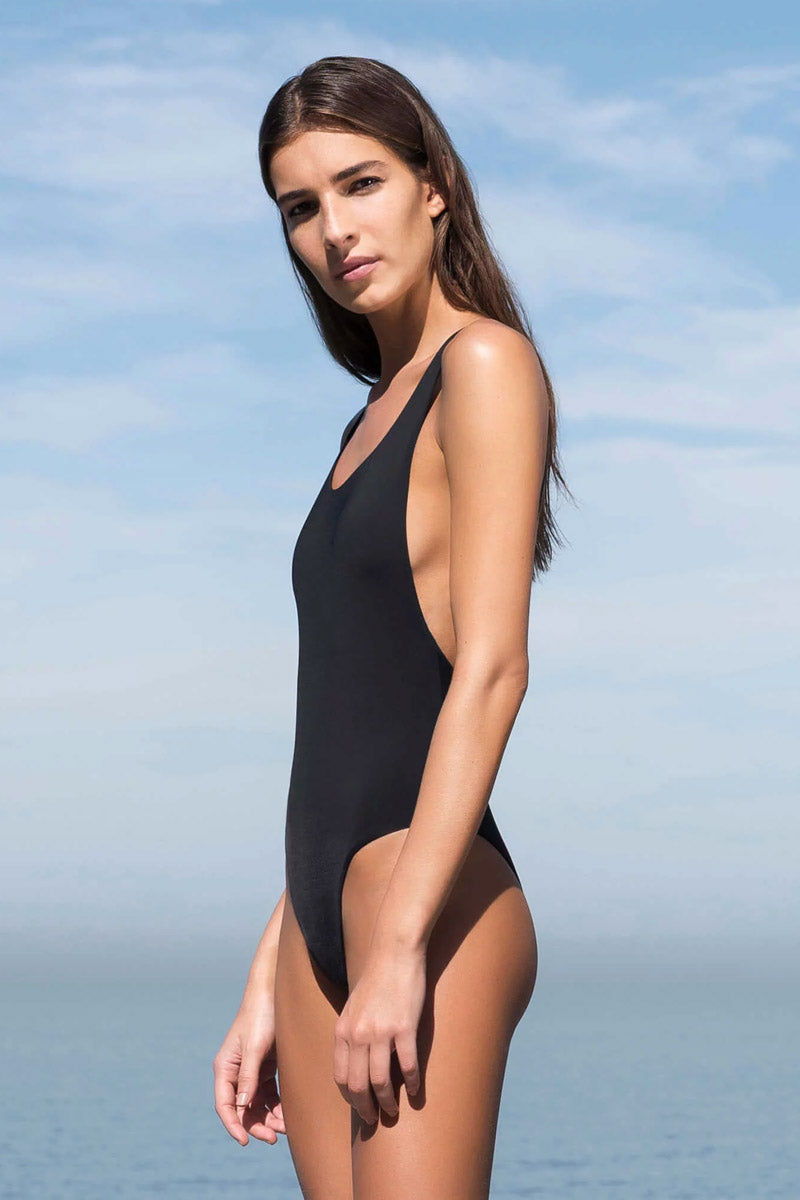 HAIGHT Thin Strap One Piece Swimsuit - Black One Piece | Black| Haight Thin Strap One Piece Swimsuit - Black Scoop neckline  Thin back straps  Cheeky coverage  Side View