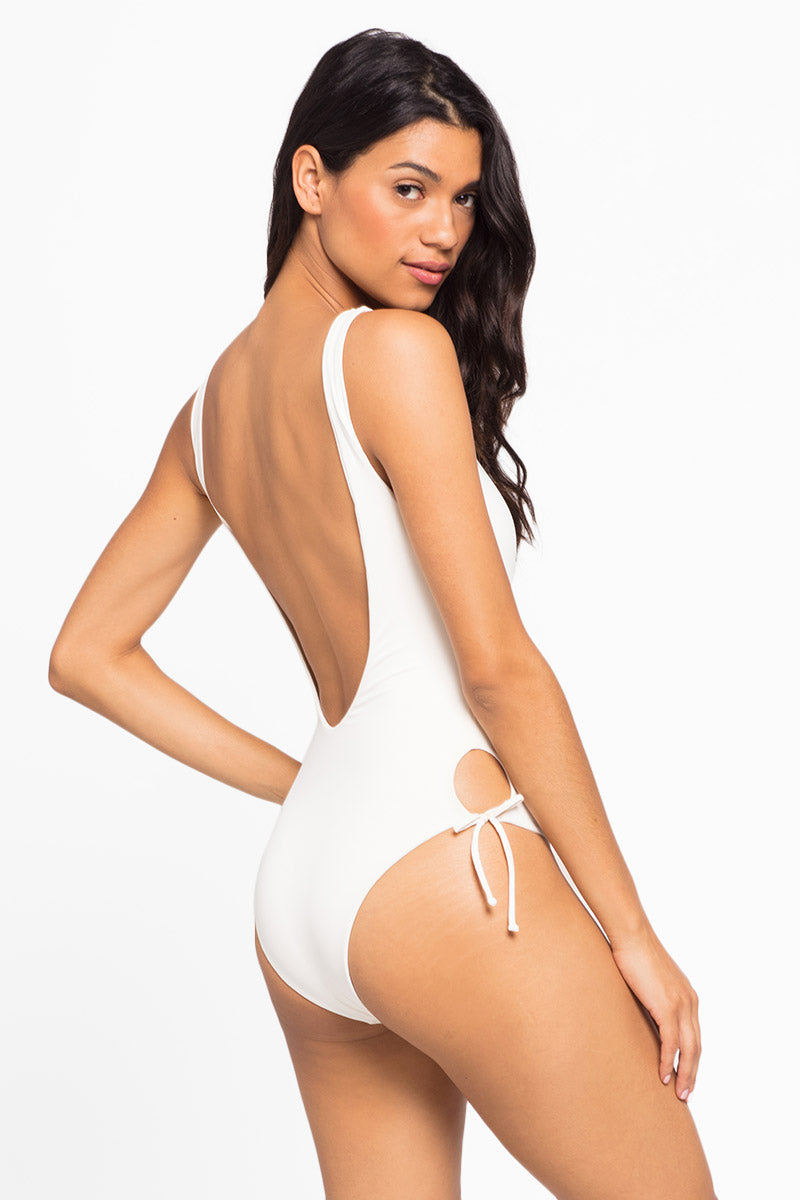 L SPACE Jenn Bow Ties One Piece Swimsuit - Cream One Piece | Cream| L Space Jenn Bow Ties One Piece Swimsuit - Cream Scoop neckline Front tie closure Side tie detail Thick shoulder straps Low back High cut leg  Cheeky coverage Front ViewCream| L Space Jenn Bow Ties One Piece Swimsuit - Cream Scoop neckline Front tie closure Side tie detail Thick shoulder straps Low back High cut leg  Cheeky coverage Back View