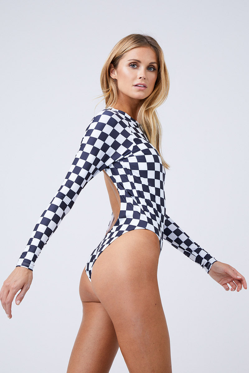 ABYSSE Billie Long Sleeve One Piece Swimsuit - Black And White One Piece | Black and White|Abysse Billie Long Sleeve One Piece Swimsuit - Black Features:  High neck Bow Tie Neck Closure Open Back High waisted  2 inch elastic support Dry Fast and UV protective Made in California out of 100% Italian Recycled Fabric (given new life through recycling fishing nets) Side View
