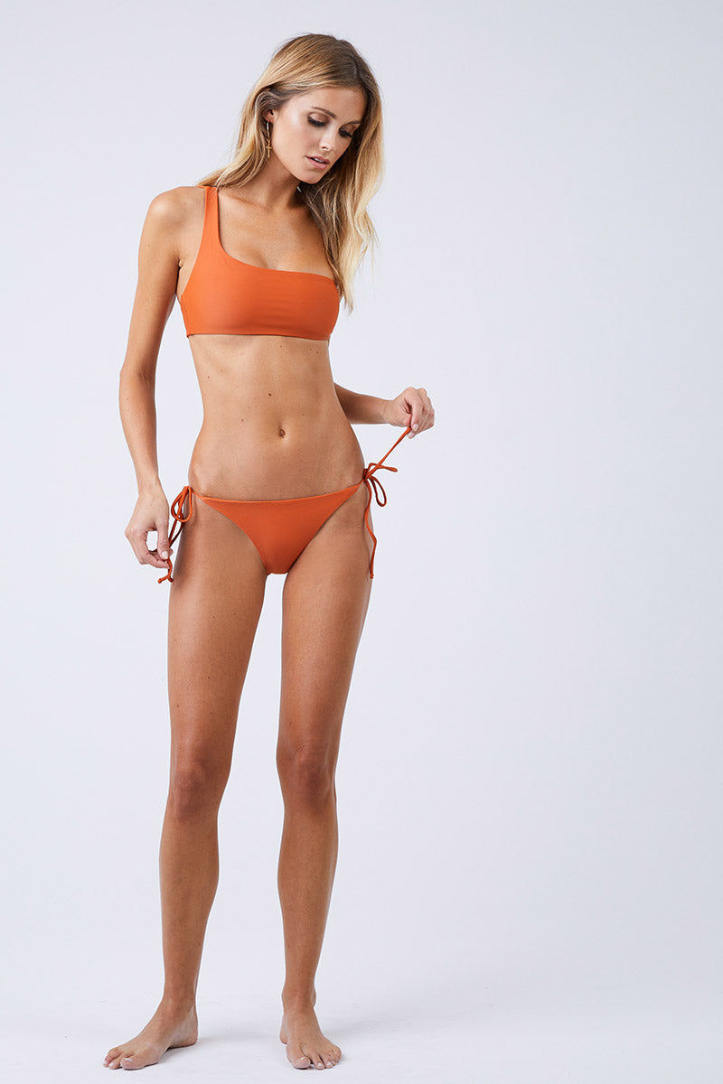 JADE SWIM Links Tie Sides Bikini Bottom - Amber Bikini Bottom | Amber| Jade Swim Links Tie Side Bikini Bottom - Amber Tie Side Bottom  Moderate Coverage  Made in Los Angeles 82% Nylon, 18% Lycra Spandex Care  Hand wash, lay flat to dry Chlorine, oil and cream resistant Front View