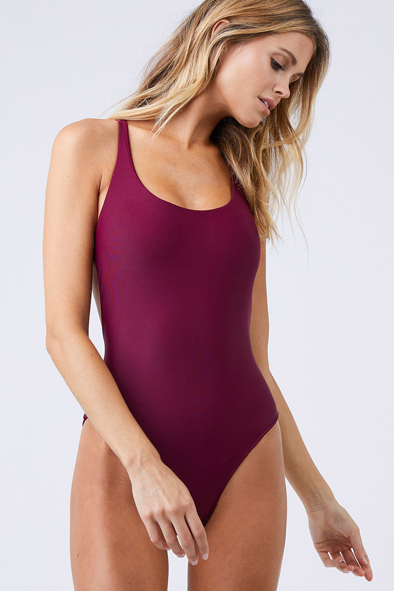 JADE SWIM Asterik Scoop Neckline One Piece Swimsuit - Fig One Piece | Fig| Jade Swim Asterik Scoop Neckline One Piece Swimsuit - Fig Scoop Neckline  Criss Cross Back Straps  Center Horizontal Back Strap Moderate Coverage  Made in LA  82% Nylon 18% Spandex     Care  Hand wash, lay flat to dry Chlorine, oil and cream resistant. Front View
