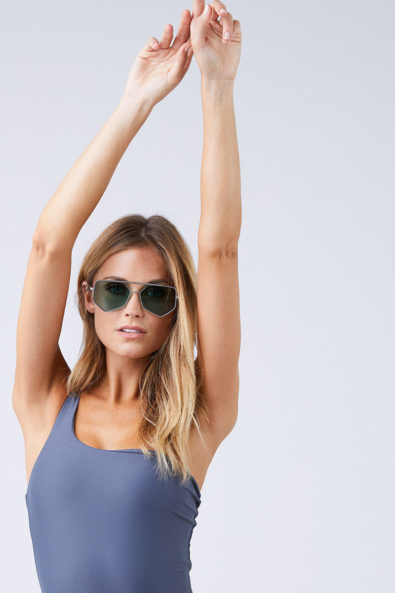 JADE SWIM Apex One Shoulder One Piece Swimsuit - Slate One Piece | Slate| Jade Swim Apex One Shoulder One Piece Swimsuit - Slate. Side View Asymmetrical One Shoulder One Piece Swimsuit Slate Gray Thin Double Back Straps Cheeky to Moderate Coverage