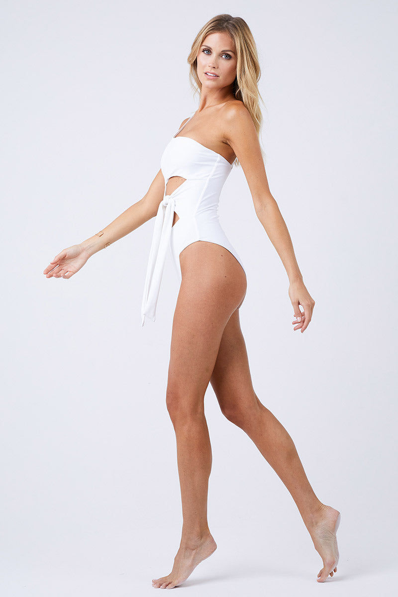 JADE SWIM Collision Cut Out One Piece Swimsuit - White One Piece | White| Jade Swim Collision Cut Out One Piece Swimsuit - White  Side View All White Asymmetrical One Piece Swimsuit One Shoulder Off Center Front Cut Outs Knot Tie Detail Single Thin Back Strap Moderate Coverage